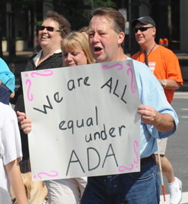 We Are All Equal Under ADA 2010 protest sign