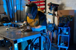 Welder with a disability working