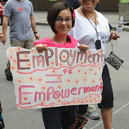 Employment = Empowerment protest sign