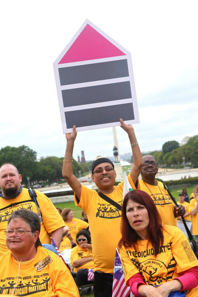 Advocate Holds Fair Housing Symbol at 2011 My Medicaid Matters Rally