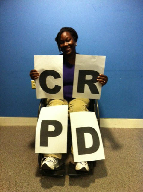 Student from Ghana holds CRPD support sign