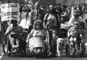 """Old school disability rights protest – signs read """"we shall overcome"""" and """"access is a civil right"""" – photo by Tom Olin"""